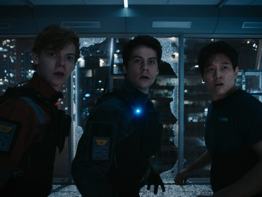 Newt (Thomas Brodie-Sangster), Thomas (Dylan O'Brien) and Minho (Ki Hong Lee) seek to survive in 'Maze Runner: The Death Cure.'