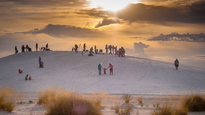 In this 2015 file photo, several spectators gather at the White Sands Balloon Invitational at White Sands National Monument.