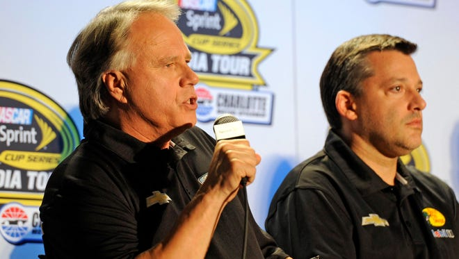 Stewart Haas Racing co-owner Gene Haas addresses the media while seated next to driver Tony Stewart (right) during the Sprint Media Tour at the Charlotte Convention Center.