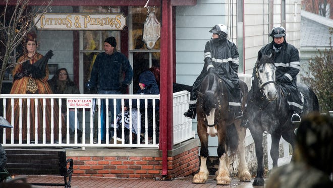 Pennsylvania State Police officers on horseback wait for the Remembrance Day Parade to begin, November 18, 2017. Pennsylvania State Police had a strong presence in the area, with police bomb detection dogs and FBI securing the area.