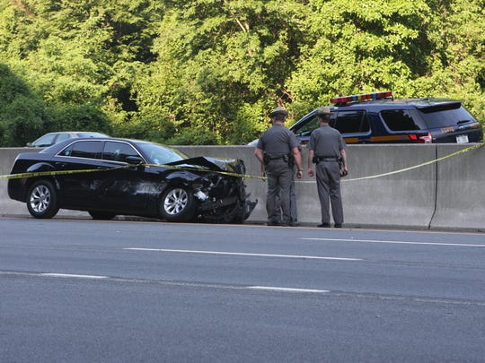 New York state police investigate a car crash on Interstate 87 northbound on Monday, June 27, 2016.