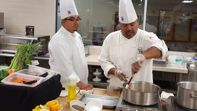 Daniel Guerra, left, and Jesus Lugo, instructors with the Culinary Arts Department at El Paso Community College demonstrate healthy cooking methods. The college is partnering with several agencies in El Paso to spread the word on the benefits of eating healthy.