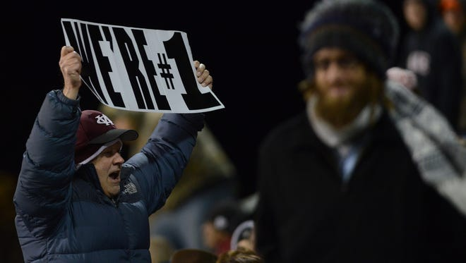 An Owen fan shows his support Friday night at Polk County.