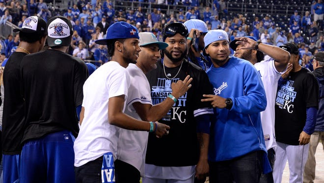 Kansas City Royals starting pitcher Johnny Cueto poses for photos with friends after defeating the Houston Astros in game five of the ALDS at Kauffman Stadium.