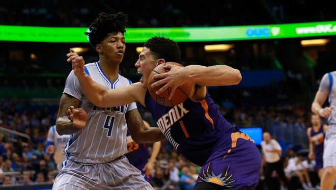 March 4, 2016; Orlando: Phoenix Suns guard Devin Booker (1) drives to the basket as Orlando Magic guard Elfrid Payton (4) defends during the first quarter at Amway Center.