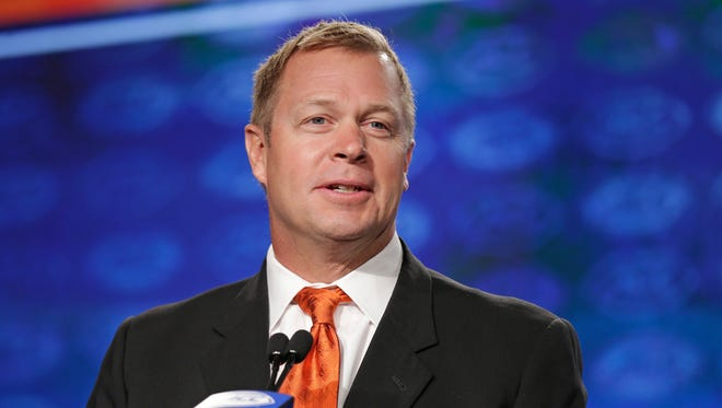 Virginia head coach Bronco Mendenhall speaks to the media during the Atlantic Coast Conference NCAA college football media day in Charlotte, N.C., Friday, July 14, 2017.