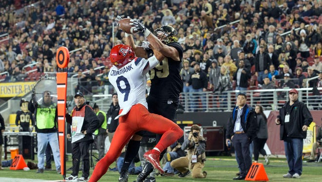 Dec 27, 2017: Purdue Boilermakers tight end Brycen Hopkins (89) is unable to control the intended pass while being defended by Arizona Wildcats defensive back Dane Cruikshank (9) during the first half in the 2017 Foster Farms Bowl at Levi's Stadium.