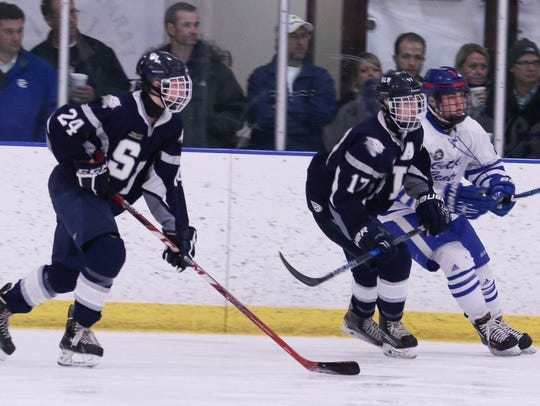 South Lyon's Jack Fredericks (24) and Anthony Bagnasco