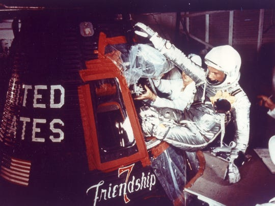 "Overall view of Astronaut John Glenn as he enters into the spacecraft ""Friendship 7"" prior to MA-6 launch operations at Launch Complex 14. The story is that Glenn asked his children for suggestions on what to name his ship. He added ""7,"" in honor of his Mercury Project astronauts."