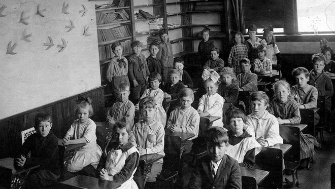 SNAPSHOT IN TIME: No doubt these students at Pleasant Hill School, circa 1920, just west of Algoma on today's State 54, went to school on daylight saving time as their city cousins did.  Daylight savings began as a war time measure just over 100 years ago and is still with us, for other reasons.  Instituted just after the U.S. entered World War I, the system was thought to be of help to parents, as children would be available for more daytime work such as in the gardens and around the home. It was also said that school children were more efficient at studies earlier in the day. An additional 15 minutes was saved by shortening the noon hour and starting earlier.