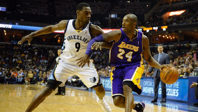 Dec 17, 2013; Memphis, TN, USA; Memphis Grizzlies shooting guard Tony Allen (9) guards Los Angeles Lakers shooting guard Kobe Bryant (24) during the fourth quarter at FedExForum. Los Angeles Lakers defeat the Memphis Grizzlies 96-92 Mandatory Credit: Justin Ford-USA TODAY Sports