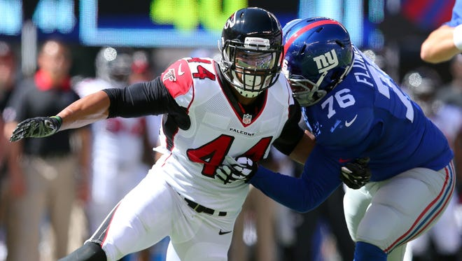 In this Sept. 20, 2015, file photo, Atlanta Falcons defensive end Vic Beasley Jr. (44) tries to get around New York Giants offensive tackle Ereck Flowers during a game at MetLife Stadium in East Rutherford, N.J.