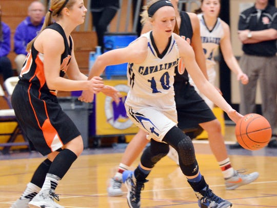 St. Thomas More's Dru Gylten dribbles away from Dell Rapids' Kaylee Hennen during their first-round game of the 2016 State Class A Girls Basketball Tournament at Watertown.