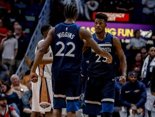 Minnesota Timberwolves guard Jimmy Butler (23) celebrates