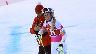 Lindsey Vonn gets help after her crash during the Audi FIS Alpine Ski World Cup Women's Super-G on on Sunday in Val d'Isere, France.