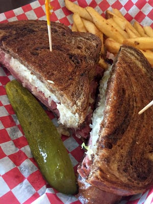 The pastrami and sauerkraut from Hank's Riverwalk Grill. The same sandwich is on the menu at Oscar's in Springdale.