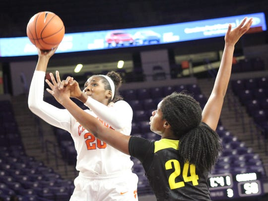 Clemson post player Sirah Diarra (20) attempts a shot while being defended by Oregon forward Ruthy Hebard (24) in Monday's game at Littlejohn Coliseum.
