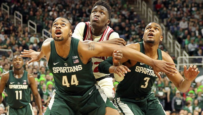 Michigan State forward Nick Ward (44) and Nebraska center Jordy Tshimanga (32) and Michigan State guard Alvin Ellis III (3) fight for position during the first half of MSU's 88-72 win Thursday at Breslin Center.
