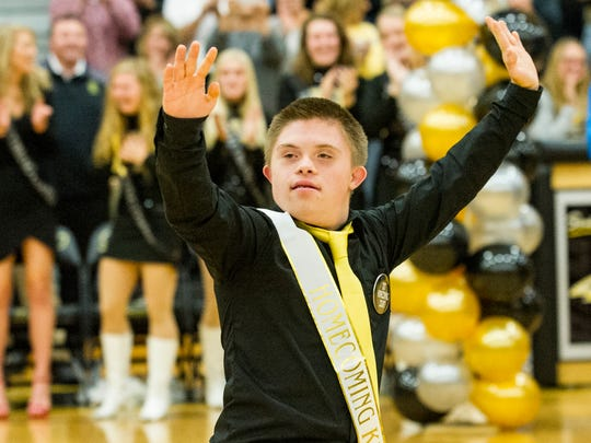 Tyler Kaut wave to his fans after being named 2017 Southeast Polk homecoming king.