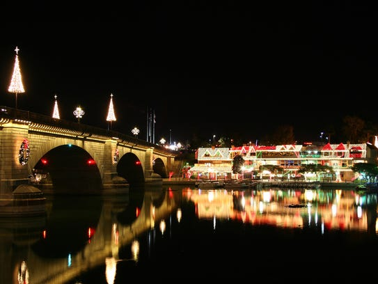 Lake Havasu City lights up for the holidays, providing a lovely backdrop for those enjoying the temporary ice-skating rink.