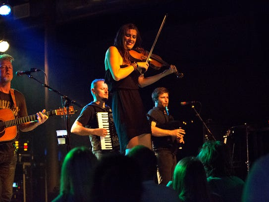 Gaelic Storm performs on stage on September 3, 2015