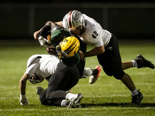 Hoover's Jerry Ziaty is tackled by Ankeny Centennial's