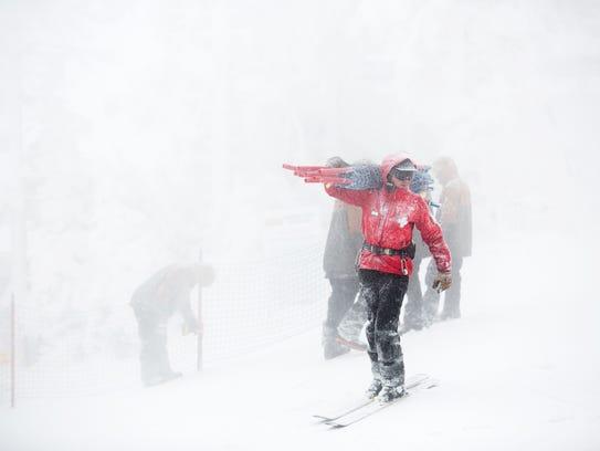 Snow patrollers on top of Killington Resort get ready