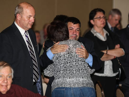 Barbara Fiala hugs her son, Tony, after conceding defeat