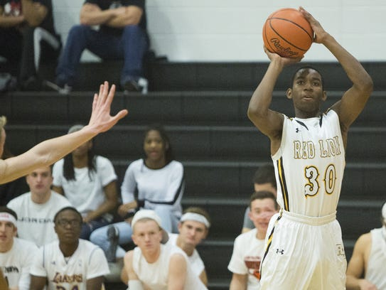 Red Lion's Jamel Foster shoots the ball during Friday's
