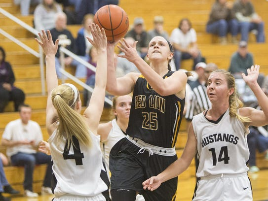Red Lion's Courtney Dimoff drives to the basket between