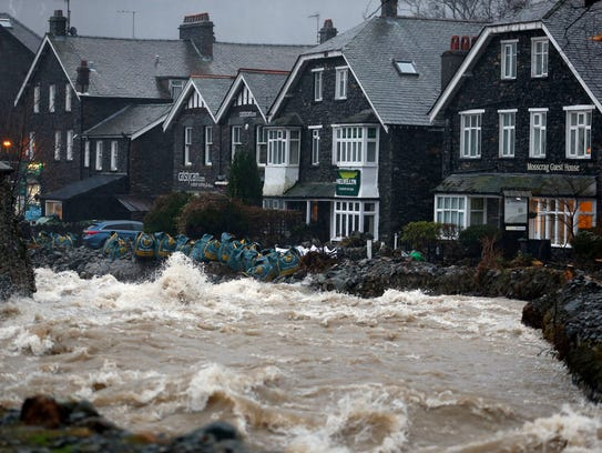 Sandbags are seen on a wall as Storm Frank causes flooding
