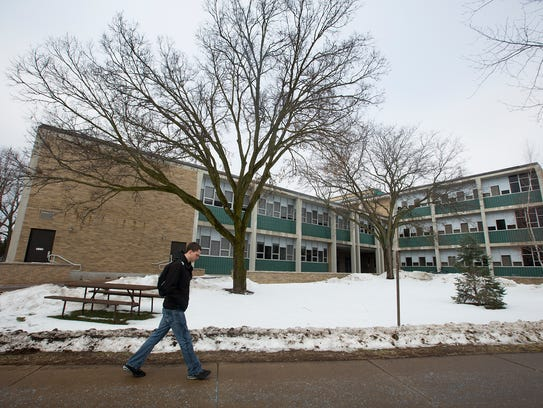 A student walks by the Science Building on the University
