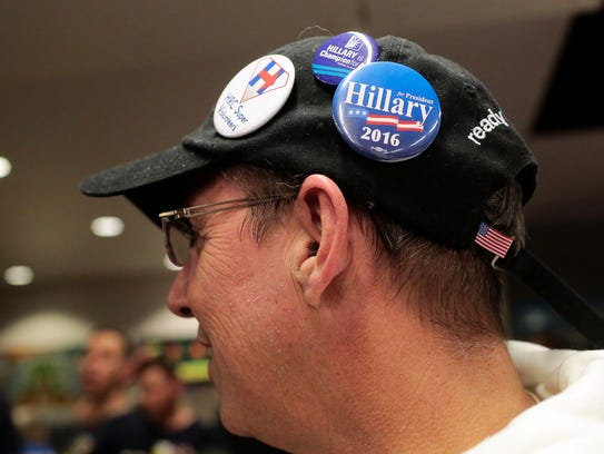 Hillary Clinton supporter Mark Murphy wears a hat adorned