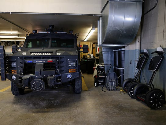 The garage is crowded with storage, vehicles and other