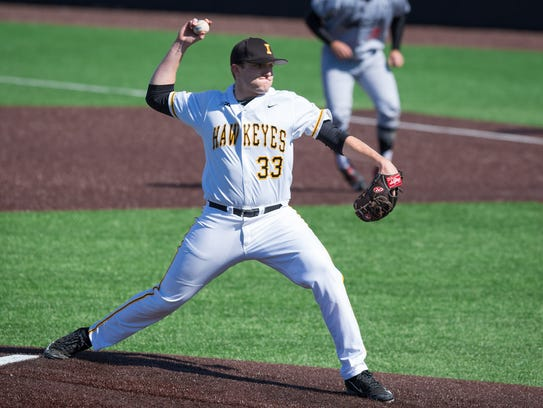 Iowa pitcher C.J. Eldred (33) throws in the top of