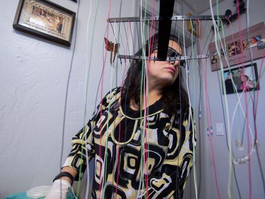 Owner of Senza Pelo Med Spa, Maria DeNicola, gets ready