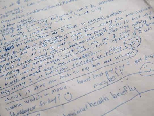 Notes written by Alex Jacobsen are seen at his father