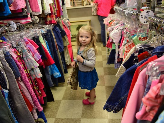 McKenzie Klipp, 3, models fashion in Upscale Consignment