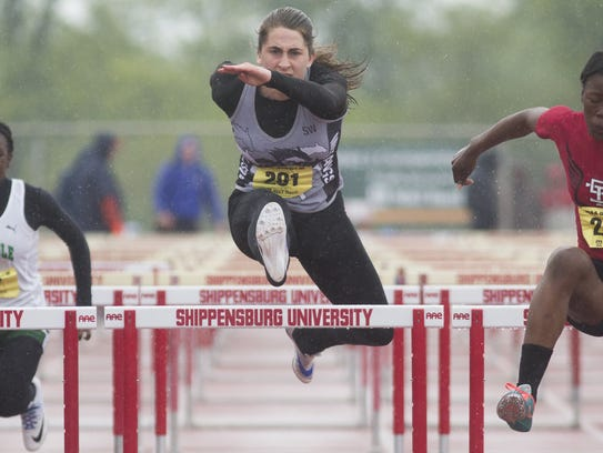 South Western's Lynne Mooradian, center, competes in
