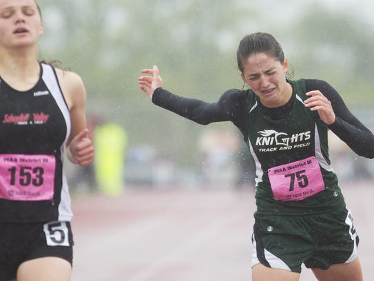 Fairfield's Hannah Logue crosses the finish line in