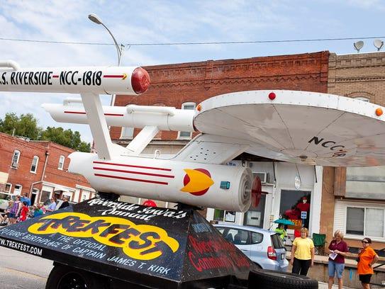 The USS Enterprise float rolls through downtown Riverside