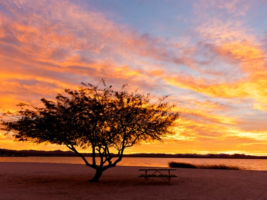 A dazzling sunset over the beach at Lake Havasu State