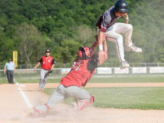 Meyersdale's catcher Max Caton tags out Cooper Grove