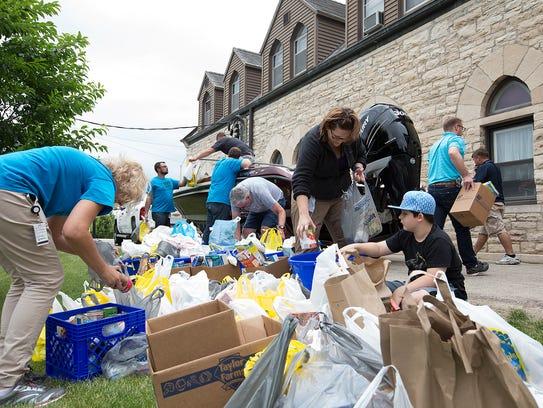 Mercury Marine and Fondy Food Pantry volunteers unload