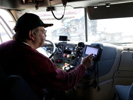 David Hoppe, driver with RGL, logs into a computer