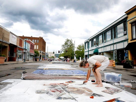 Dan Kniffin, of Elmira, works on his chalk artwork
