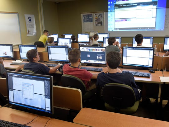 Students learn how to build web pages on Friday, July