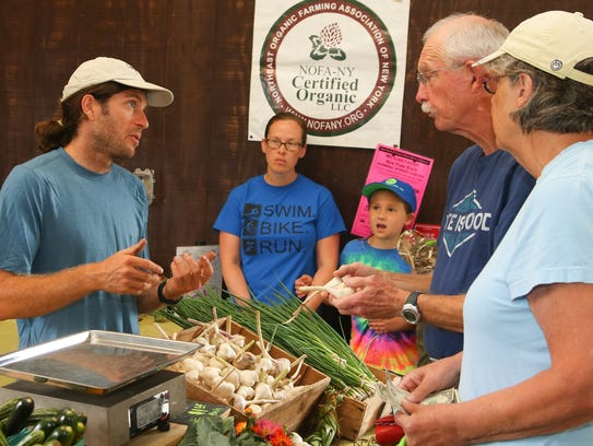 Bret Morris, left, of Shared Roots Farm in McGraw,