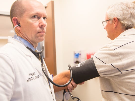 Dr. Lance Sherley of Premier Medical Group examines