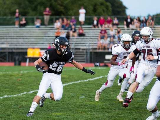 South Western's Drew Hartlaub (28) looks for an opening